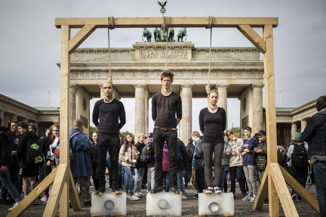 Protesters on a gallow standing on ice are pictured within the worldwide movement 'Fridays for Future' near the Brandenburg Gate on September 20, 2019 in Berlin, Germany. (Photo: Florian Gaertner/Photothek via Getty Images)