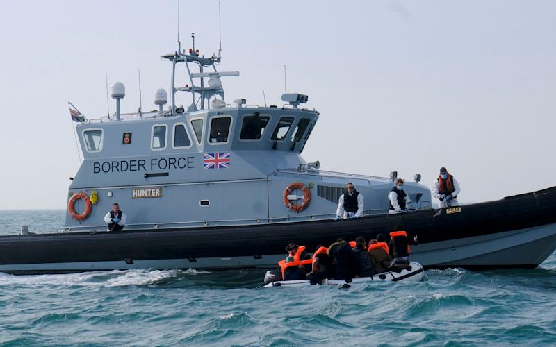 A British vessels arrives to lead the group on the shore, and safety - Steve Finn/Steve Finn