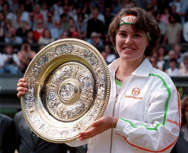 Martina Hingis won the Australian Open, Wimbledon and the US Open aged 16 in 1997 (PA).