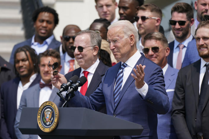 President Joe Biden, surrounded by members of the Tampa Bay Buccaneers, speaks during a ceremony on the South Lawn of the White House, in Washington, Tuesday, July 20, 2021, where the president honored the Super Bowl Champion Tampa Bay Buccaneers for their Super Bowl LV victory. (AP Photo/Manuel Balce Ceneta)