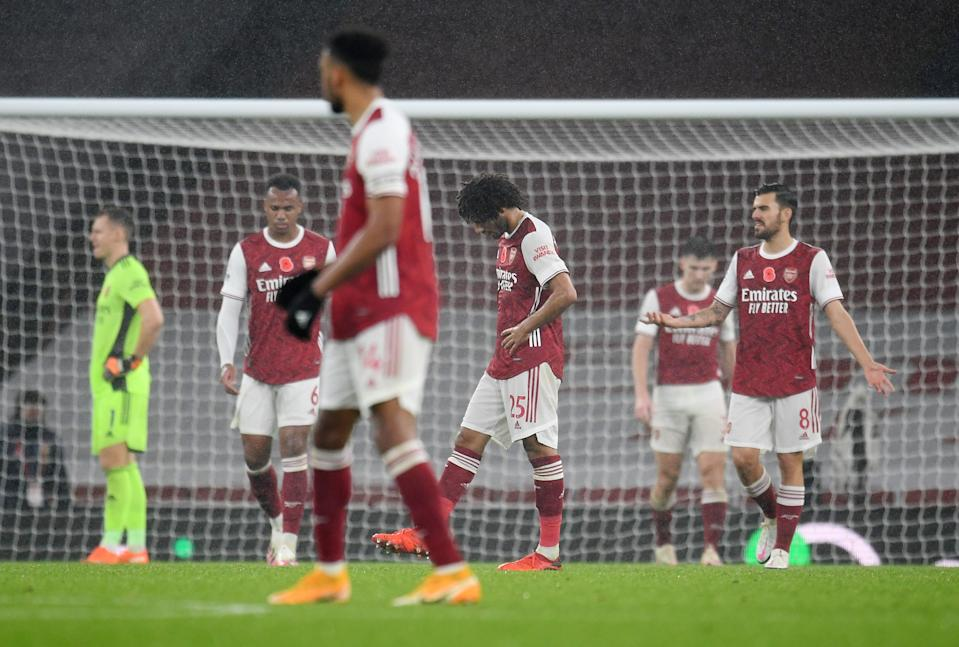 Arsenal players looking dejected after conceding their second goal against Aston Villa.