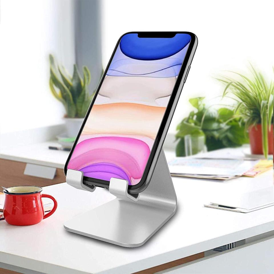 <p>Great for their work desk, the <span>CreaDream Cell Phone Stand</span> ($10) will keep their phone at arm's reach.</p>