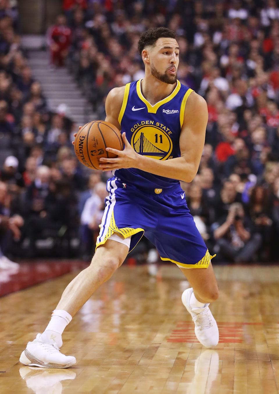 Klay Thompson #11 of the Golden State Warriors handles the ball on offense against the Toronto Raptors in the second quarter during Game One of the 2019 NBA Finals at Scotiabank Arena on May 30, 2019 in Toronto, Canada. (Photo by Gregory Shamus/Getty Images)