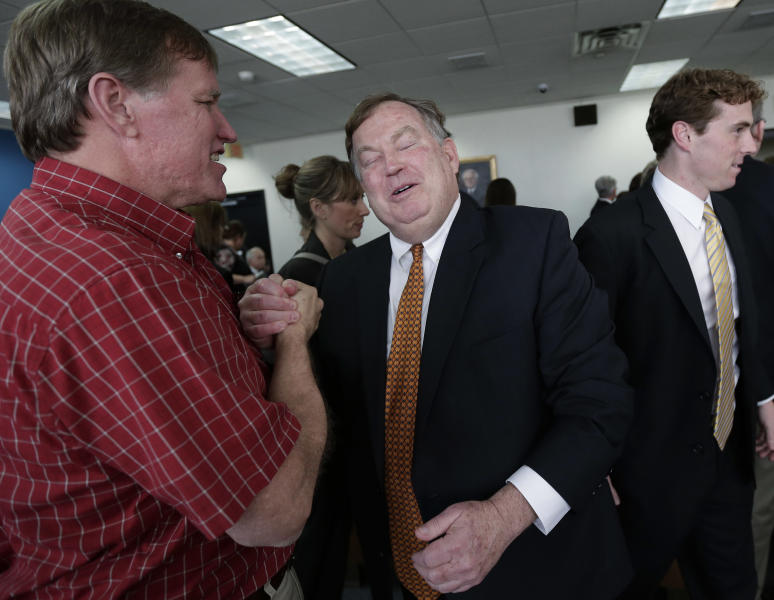 Attorney Rick Gray, center, representing more than 400 districts mostly in poorer areas of the state, reacts as he is congratulated following a ruling in a consolidated six-lawsuit case contending the school finance system violates the Texas Constitution, Monday, Feb. 4, 2013, in Austin, Texas. State District Judge John Dietz ruled that he system Texas uses to fund public schools violates the state's constitution by not providing enough money to school districts and failing to distribute the money in a fair way. (AP Photo/Eric Gay)