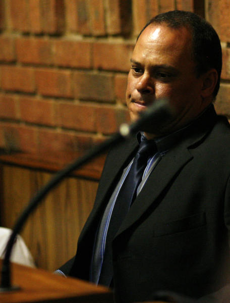 "Investigating officer Hilton Botha sits inside the witness box during the bail hearing for Oscar Pistorius at the magistrate court in Pretoria, South Africa, Thursday, Feb. 21, 2013. South Africa's National Prosecuting Authority acknowledged that the timing of attempted murder charges against a police detective leading the investigation into Oscar Pistorius is ""totally weird"" and that he should dropped from the case against the world-famous athlete. (AP Photo/Themba Hadebe)"