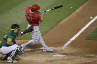 Los Angeles Angels' Mike Trout shatters his bat after hitting a two run single off Oakland Athletics' J.B. Wendelken in the sixth inning of a baseball game Friday, Aug. 21, 2020, in Oakland, Calif. (AP Photo/Ben Margot)