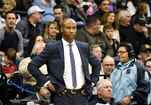 "UTEP assistant <a class=""link rapid-noclick-resp"" href=""/ncaab/players/151088/"" data-ylk=""slk:Lamont Smith"">Lamont Smith</a> resigned on Wednesday after he was implicated in the massive college admissions scandal. (AP Photo/Denis Poroy)"