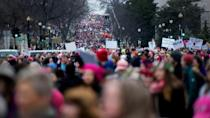 """The human tide flooding the US capital appeared to dwarf the throngs of Donald Trump supporters in red """"Make America Great Again!"""" caps who the day before had cheered his swearing-in"""