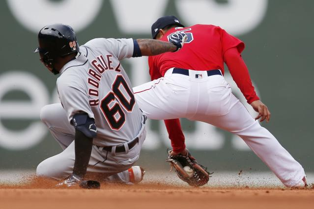 Boston Red Sox's Dana LeVangie (60) slides safely into second base with a double behind Boston Red Sox's Tzu-Wei Lin (5) during the eighth inning of the first game of a baseball doubleheader in Boston, Tuesday, April 23, 2019. (AP Photo/Michael Dwyer)