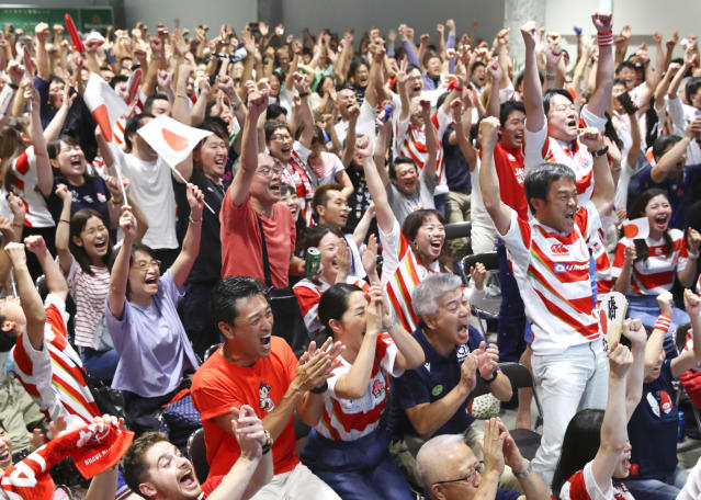 Supporters celebrate as Japan team scored a try against Ireland during the Rugby World Cup Pool A game, during a public-viewing event in Tokyo, Saturday, Sept. 28, 2019. (Kyodo News via AP)