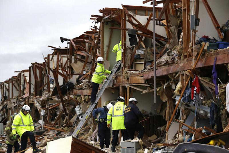 Firefighters conduct search and rescue of an apartment destroyed by an explosion at a fertilizer plant in West, Texas, Thursday, April 18, 2013. A massive explosion at the West Fertilizer Co. killed as many as 15 people and injured more than 160, officials said overnight. (AP Photo/LM Otero)