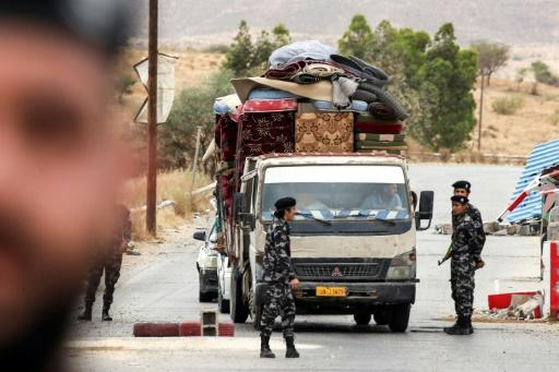 Checkpoints like this one manned by forces loyal to Libya's UN-recognised unity government outside the recently recaptured town of Tarhuna, are the most obvious sign of the division dogging the country's efforts against the coronovirus