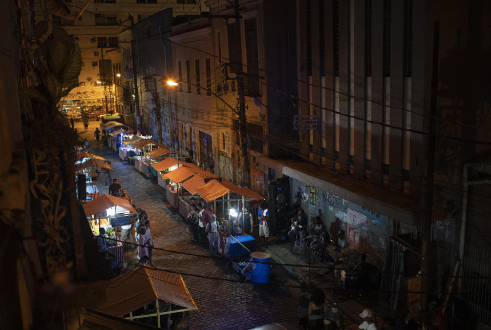 Brazilian band Atitude Nossa plays samba at a street as the restrictions related to the COVID-19 pandemic are eased in Rio de Janeiro, Brazil, Monday, Oct. 5, 2020. Since the beginning of October, live shows are now permitted in Rio de Janeiro. (AP Photo/Silvia Izquierdo)