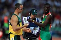 In a gesture of camaraderie and respect, Kirani James (R) of Grenada exchanges bibs with Oscar Pistorius (L) of South Africa after the Men's 400m semifinal on Day 9 of the London 2012 Olympic Games at the Olympic Stadium on August 5, 2012 in London, England. (Photo by Phil Walter/Getty Images)