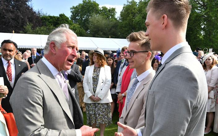 Prince Charles at a garden party in Buckingham Palace in 2018 - PA