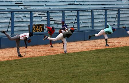 FILE PHOTO: Players of the Industriales team practice at the Latinoamericano stadium in Havana, Cuba, May 25, 2017. REUTERS/Stringer/File Photo