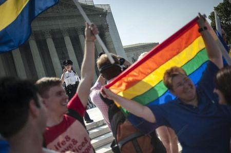 Demonstrators in support of same-sex marriage gather in anticipation of two high-profile rulings regarding same-sex marriage at the US Supreme Court in Washington