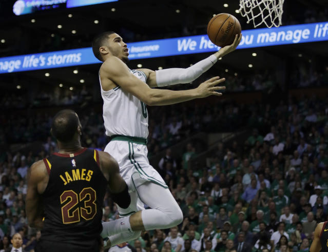 Boston Celtics forward Jayson Tatum (0) goes to the basket over Cleveland Cavaliers forward LeBron James (23) during the fourth quarter of Game 5 of the NBA basketball Eastern Conference finals Wednesday, May 23, 2018, in Boston. (AP Photo/Charles Krupa)
