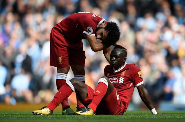 <p>Mohamed Salah of Liverpool comforts Sadio Mane of Liverpool after he was to sent off </p>