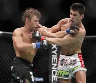 Urijah Faber and Dominick Cruz trade blows during their 2011 fight. (AP)