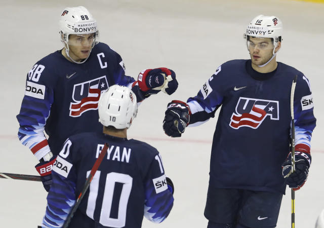Alex Debrincat of the US, right, celebrates with teammates Patrick Kane, left, and Derek Ryan, center, after scoring his sides fourth goal during the Ice Hockey World Championships group A match between the United States and Great Britain at the Steel Arena in Kosice, Slovakia, Wednesday, May 15, 2019. (AP Photo/Petr David Josek)