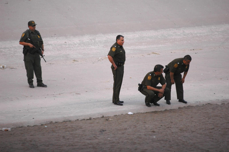 FILE - In this June 7, 2010, file photo, U.S. border patrol agents examine the area near where 14-year-old Mexican youth Sergio Adrian Hernandez Huereca was killed, allegedly shot by a U.S. Border Patrol agent after a confrontation under the Paso Del Norte border bridge in Ciudad Juarez, Mexico. The Border Patrol's parent agency decided to continue allowing agents to use deadly force against rock-throwers and assailants in vehicles, despite recommendations of a government commissioned review to end the practice. (AP Photo/File)