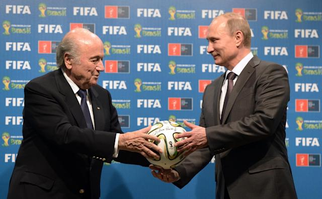 FILE - In this file photo taken on Sunday, July 13, 2014, FIFA President Sepp Blatter, left, and Russian President Vladimir Putin hold a soccer ball during the official ceremony of handover to Russia as the 2018 World Cup hosts, after the World Cup final soccer match between Germany and Argentina at the Maracana Stadium in Rio de Janeiro, Brazil. (AP Photo/RIA-Novosti, Alexei Nikolsky, Presidential Press Service, File)