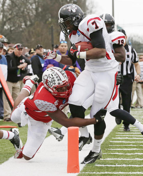 Valdosta State running back Cedric O'Neal (7) is stopped short of the goal by Winston Salem State defender Malcolm Rowe (13) in the first half of an NCAA Div II national championship college football game at Braly Municipal Stadium in Florence, Ala., Saturday, Dec. 15, 2012. (AP Photo/Dave Martin)