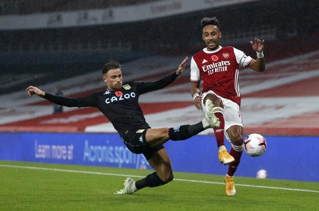 Pierre-Emerick Aubameyang, right, is tackled by Villa's Matty Cash
