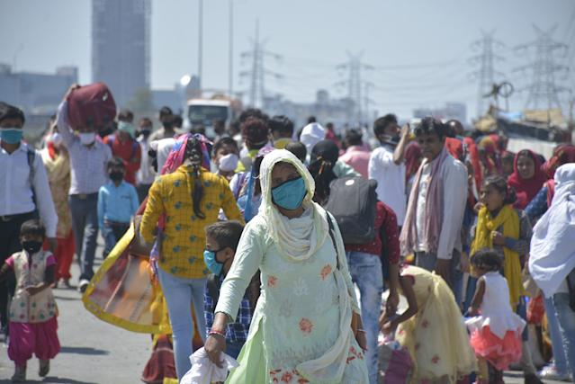 GHAZIABAD, INDIA - MARCH 29: Migrant workers head home on Day 5 of the 21 day nationwide lockdown imposed by PM Narendra Modi to curb the spread of coronavirus, at NH9 road, near Vijay Nagar, on March 29, 2020 in Ghaziabad, India. (Photo by Sakib Ali/Hindustan Times via Getty Images)