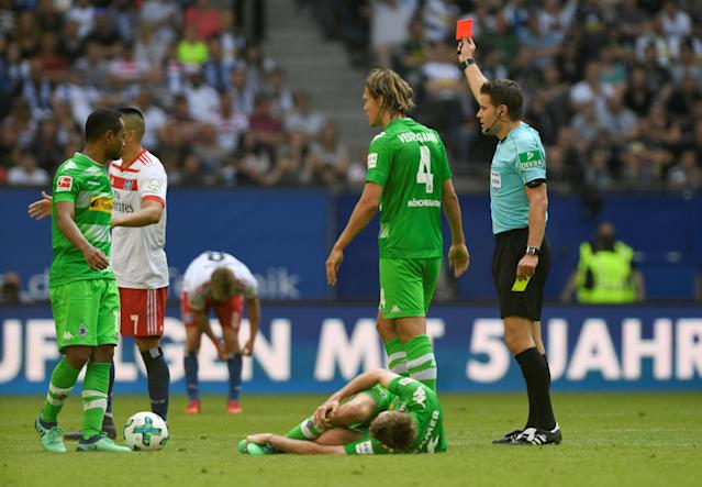 Soccer Football - Bundesliga - Hamburger SV v Borussia Moenchengladbach - Volksparkstadion, Hamburg, Germany - May 12, 2018 Hamburg's Bobby Wood is shown a red card by referee Felix Brych REUTERS/Fabian Bimmer DFL RULES TO LIMIT THE ONLINE USAGE DURING MATCH TIME TO 15 PICTURES PER GAME. IMAGE SEQUENCES TO SIMULATE VIDEO IS NOT ALLOWED AT ANY TIME. FOR FURTHER QUERIES PLEASE CONTACT DFL DIRECTLY AT + 49 69 650050