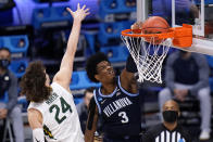 Villanova forward Brandon Slater (3) dunks on Baylor guard Matthew Mayer (24) in the second half of a Sweet 16 game in the NCAA men's college basketball tournament at Hinkle Fieldhouse in Indianapolis, Saturday, March 27, 2021. (AP Photo/AJ Mast)