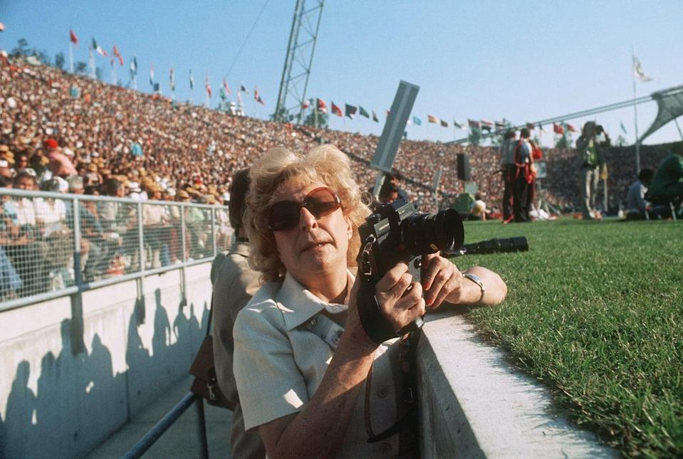 """<div class=""""inline-image__caption""""><p>Leni Riefenstahl, German photographer and filmmaker notorious for her artistic collaboration with Adolf Hitler, takes pictures on August 27, 1972, in the Olympic stadium in Munich during the 1972 Olympic games. </p></div> <div class=""""inline-image__credit"""">AFP/Getty</div>"""