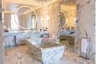 """<p>It is in one of Paris' most emblematic buildings on the Place de la Concorde that <a href=""""https://www.rosewoodhotels.com/en/hotel-de-crillon"""" rel=""""nofollow noopener"""" target=""""_blank"""" data-ylk=""""slk:Hotel de Crillon"""" class=""""link rapid-noclick-resp"""">Hotel de Crillon</a> seduces every one of its guests. The thousands of enchanting details imbue the property with charm and refinement, the perfect balance between its historic soul and modernity. For the reopening of the Palace five years ago, no fewer than 147 artists and 250 French craftsmen worked hand in hand under the art direction of Aline Asmar d'Amman. The 124 rooms and suites, one of which has been designed by Karl Lagerfeld himself, mix beautiful antiques and curated art objects. If you feel like you need a break far away from the capital's crowd, the Sisley Signature Treatment or the fairy swimming pool with its 17,600 gold tiles, are exactly what you need. </p>"""
