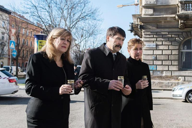 House of Terror Museum director Maria Schmidt, Hungarian president János Áder and his wife, Anita Herczegh, mark Memorial Day for the Victims of Communism in February outside the museum in Budapest.