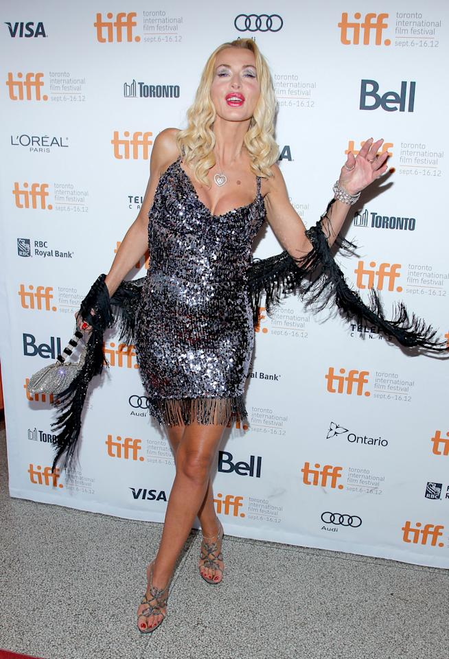 WORST: Showing up third-to-last day of the festival, Italian model Valeria Marini made it just in time to make the list of worst-dressed at TIFF. This sequined dress is an eyesore, and there's so much makeup and other distracting elements that we're not sure where to look -- not that we want to.