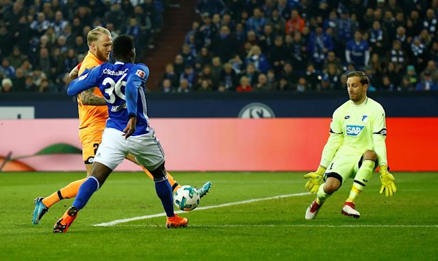 Soccer Football - Bundesliga - Schalke 04 vs TSG 1899 Hoffenheim - Veltins-Arena, Gelsenkirchen, Germany - February 17, 2018 Schalke's Breel Embolo scores past Hoffenheim's Oliver Baumann but his goal is subsequently disallowed after consultation with the video assistant referee REUTERS/Leon Kuegeler DFL RULES TO LIMIT THE ONLINE USAGE DURING MATCH TIME TO 15 PICTURES PER GAME. IMAGE SEQUENCES TO SIMULATE VIDEO IS NOT ALLOWED AT ANY TIME. FOR FURTHER QUERIES PLEASE CONTACT DFL DIRECTLY AT + 49 69 650050