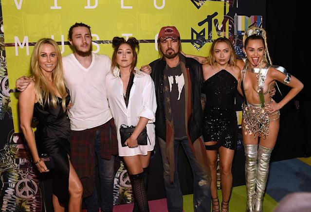<p>Even though Miley was practically naked at the 2015 MTV VMAs, it didn't deter her family from rallying around in support. The evening's host — wearing this racy number — posed with her crew (from left, Tish, brother Braison, Noah, Billy Ray, and Brandi) backstage. (Photo: Larry Busacca/Getty Images) </p>
