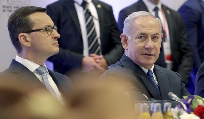 "File -- In this Thursday, Feb. 14, 2019 photo Poland's Prime Minister Mateusz Morawiecki, left, and Israeli Prime Minister Benjamin Netanyahu, right, attend a meeting in Warsaw, Poland. Poland's prime minister canceled plans for his country to send a delegation to meeting in Jerusalem on Monday after the acting Israeli foreign minister Israel Katz said that Poles ""collaborated with the Nazis"" and ""sucked anti-Semitism from their mothers' milk"". (AP Photo/Michael Sohn)"