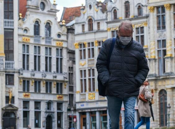 A man wearing a mask walks in Grand Place of Brussels, Belgium (EPA)