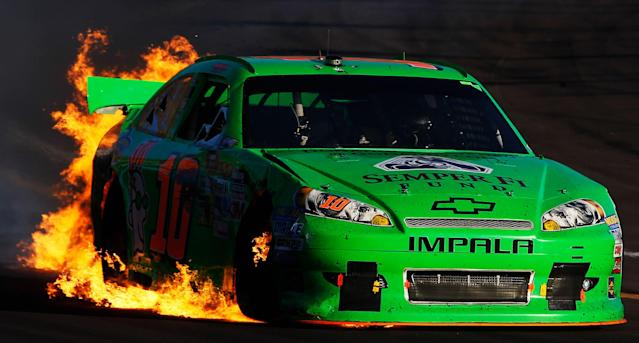 AVONDALE, AZ - NOVEMBER 11: Danica Patrick drives the wrecked #10 GoDaddy.com Chevrolet as flames shoot from the back of her car after an incident in the NASCAR Sprint Cup Series AdvoCare 500 at Phoenix International Raceway on November 11, 2012 in Avondale, Arizona. (Photo by Tom Pennington/Getty Images for NASCAR)