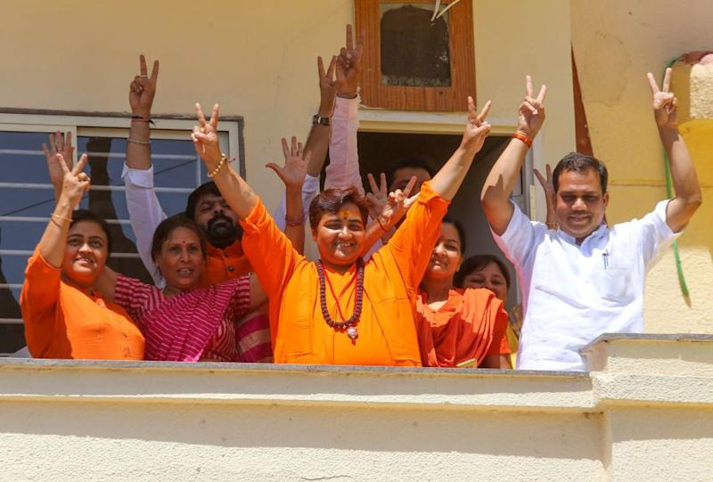 Indian Bharatiya Janata Party (BJP) candidate Pragya Singh Thakur, known as Sadhvi Pragya, gestures along with other BPJ supporters on the vote results day for India's general election at her residence in Bhopal on May 23, 2019. | Gagan Nayar—AFP/Getty Images