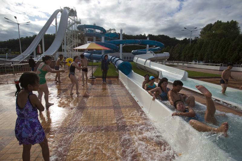 In this Sept. 8, 2012 photo, people play in a water slide at a newly-built water park in Pyongyang, North Korea. (AP Photo/David Guttenfelder)