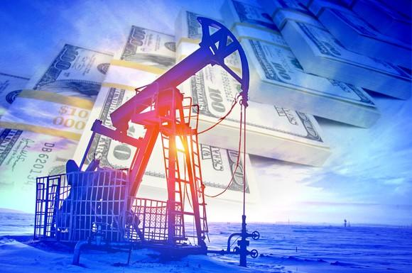 An oil pump with stacks of $100 bills in the background.