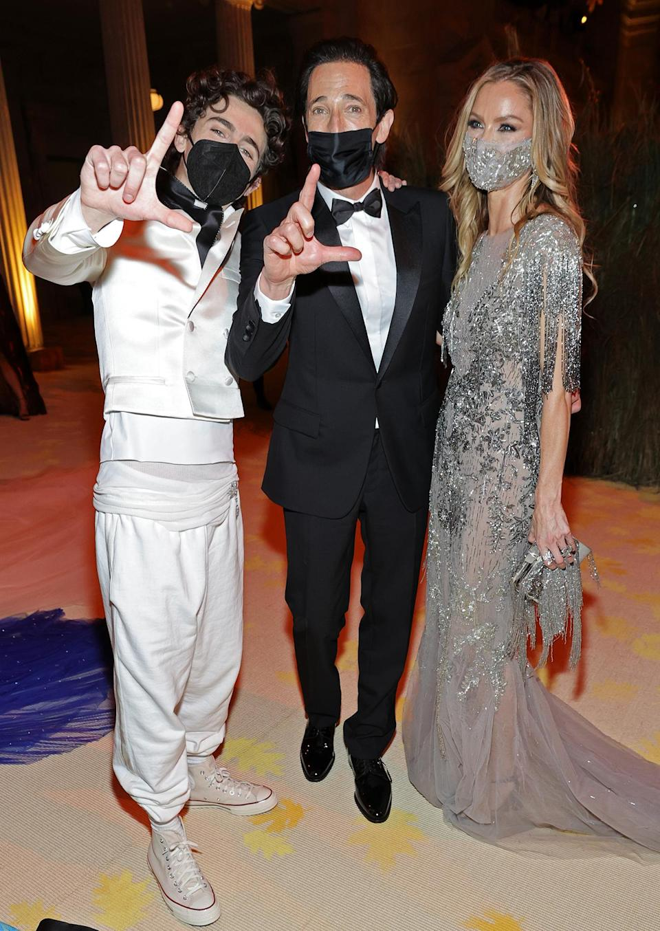 <p>posed with co-chair Chalamet for a playful photo inside the party – masks on, per rules, of course.</p>