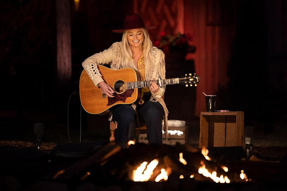 """<p>It's lit! The campfire, that is. Lambert, Jack Ingram and Jon Randall performed <a href=""""https://www.youtube.com/watch?v=QsQFbC-rbAI"""" rel=""""nofollow noopener"""" target=""""_blank"""" data-ylk=""""slk:&quot;Tequila Does&quot;"""" class=""""link rapid-noclick-resp"""">""""Tequila Does""""</a> while sitting in front of a campfire, Lambert in a maroon hat and beige fringe leather jacket. </p>"""