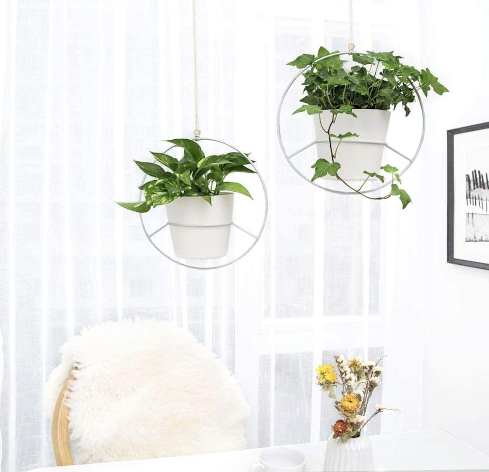 <p>This <span>Mkono Boho Hanging Planter Set</span> ($33, originally $36) will bring some texture and add visual interest to your living-room ceiling.</p>