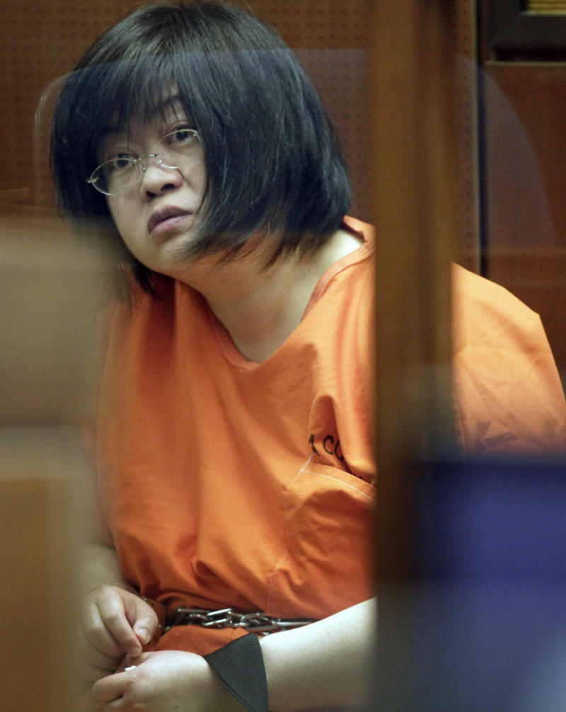 """FILE - In this Friday, March 16, 2012 file photo, Dr Hsiu Ying """"Lisa"""" Tseng listens in court during her arraignment, in Los Angeles. Testimony ended Tuesday June 26, 2012, in the three-week preliminary hearing for Tseng, charged with murder in the drug overdose deaths of three of her patients. Final arguments and the judge's ruling are expected on whether Tseng will stand trial.  (AP Photo/Nick Ut, File)"""