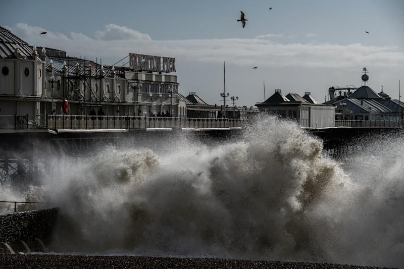 Waves crash on the beach next to Brighton pier as high winds continue following Storm Ciara (Getty Images)
