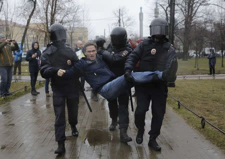 Interior Ministry officers detain a participant of an opposition protest in St. Petersburg